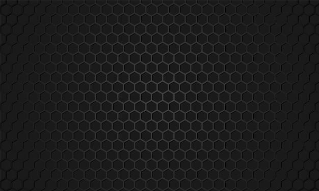 Fond texturé métallique en fibre de carbone hexagone noir.