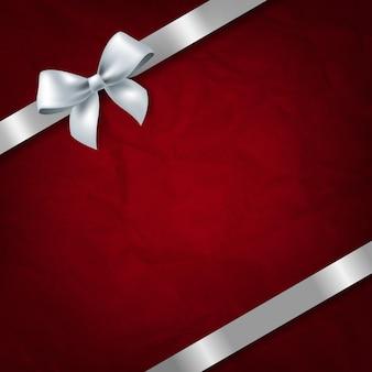 Fond de texture de papier rouge avec noeud de ruban blanc
