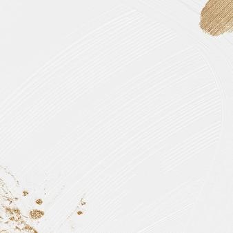 Fond texturé de peinture au pinceau blanc avec des paillettes d'or