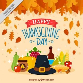 Fond thanksgiving avec des feuilles sèches et des éléments traditionnels