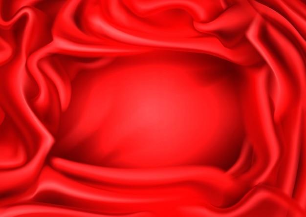 Fond en tissu drapé de soie rouge.