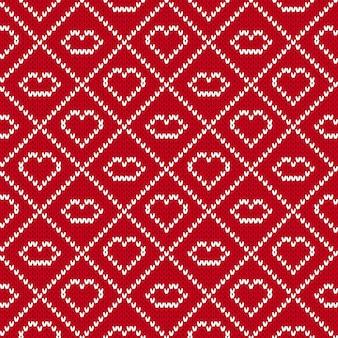 Fond en tricot avec illustration de coeurs