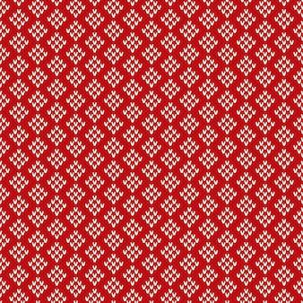 Fond de tricot sans couture de noël. motif tricoté rouge