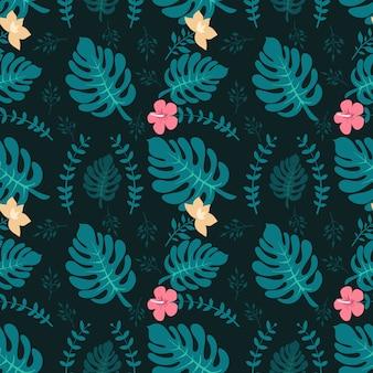 Fond tropical avec des feuilles de palmier