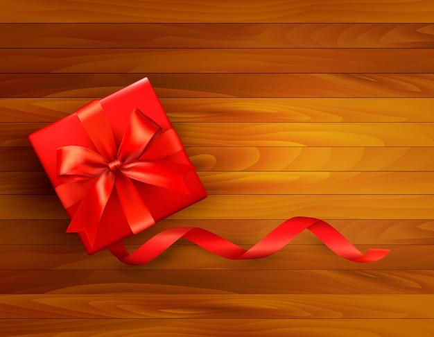 Fond de vacances avec boîte-cadeau et arc rouge.