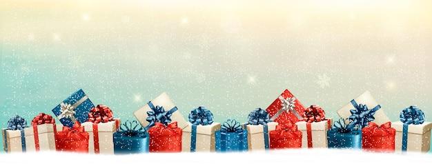 Fond de vacances de noël avec une bordure de coffrets cadeaux.