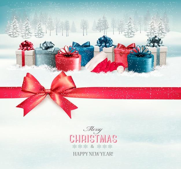 Fond de vacances de noël avec des coffrets cadeaux colorés et un ruban cadeau rouge.