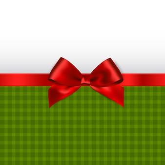 Fond de vacances de noël avec noeud de satin rouge.