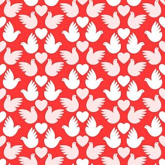 Fond de vacances avec des oiseaux rouges et coeur