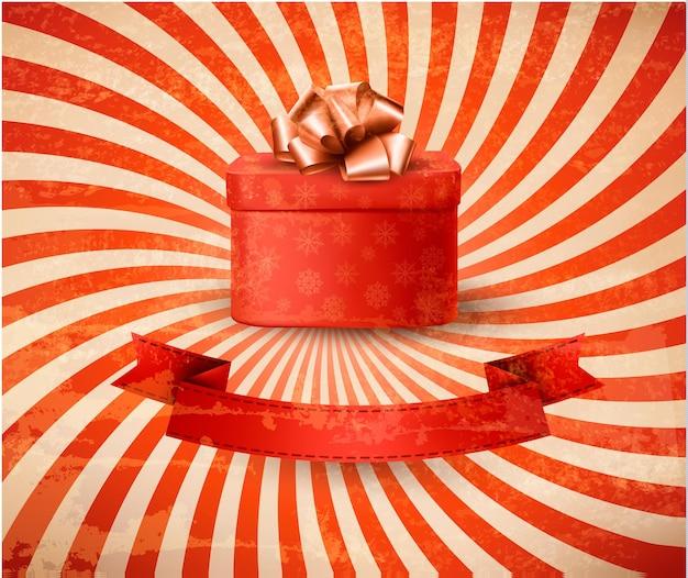 Fond de vacances vintage avec boîte-cadeau rouge.
