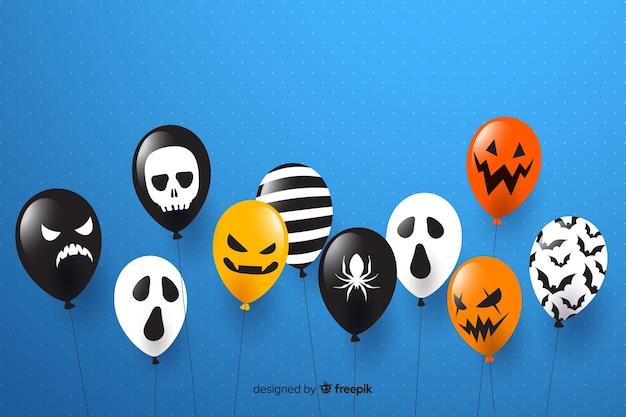 Fond de vente halloween design plat avec des ballons