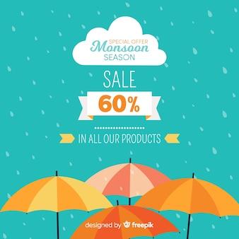 Fond de vente mousson avec des parapluies