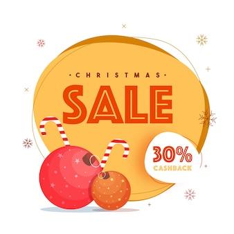 Fond de vente de noël avec des boules de noël, candy cane et offre de réduction de 30%