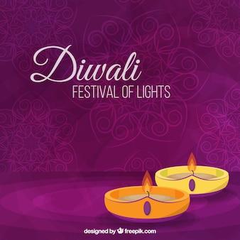 Fond violet avec des bougies de diwali