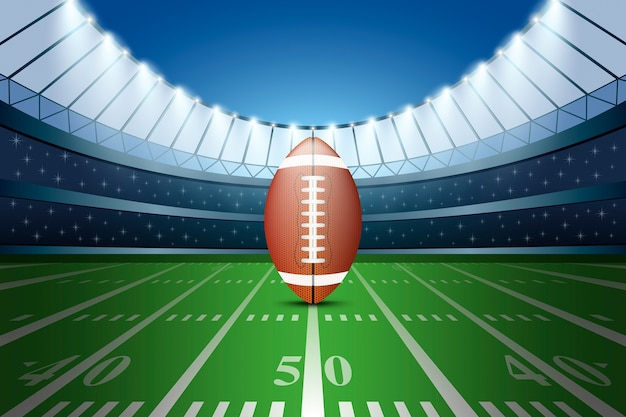 Football américain sur le terrain du stade avec des projecteurs.