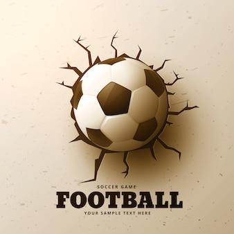 Le football frappe le mur avec des fissures