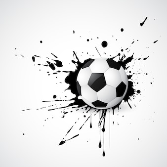 Le football placé sur le design grunge