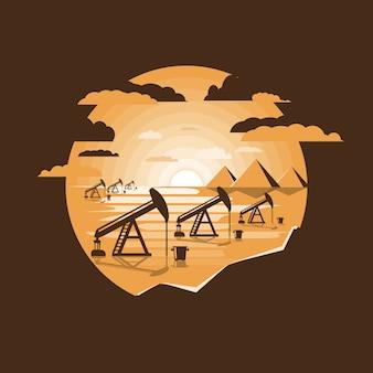 Forages et pompes à huile au coucher du soleil orange dans le désert.