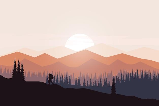 Forêt de pins dense de paysage plat avec de belles montagnes
