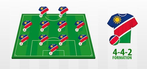 Formation de l'équipe nationale de football de namibie sur le terrain de football.