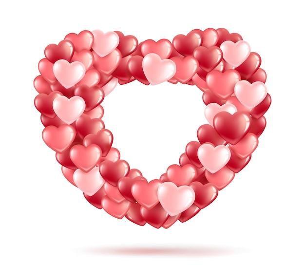 Forme d'un coeur de ballons-coeurs roses et rouges.