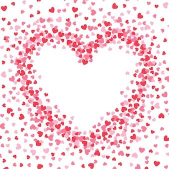 Forme de coeur, fond de confettis rouge