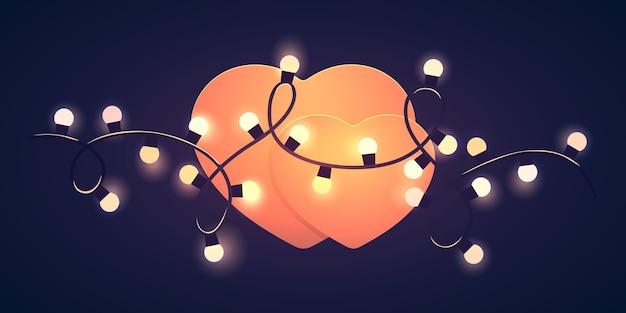 Forme de coeur avec des lumières sur fond sombre. modèle de la saint-valentin