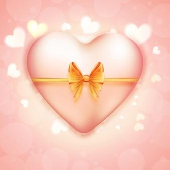 Forme de coeur rose avec ruban d'or sur fond brillant