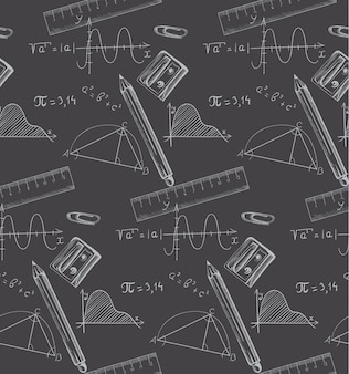 Formules mathématiques et crayons dessinés sur un tableau noir