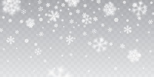 Fortes chutes de neige. chute de flocons de neige sur fond transparent. flocons de neige blancs volant dans les airs.