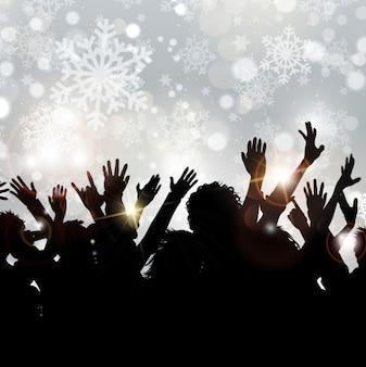 Foule silhouettes sur fond flocon de neige
