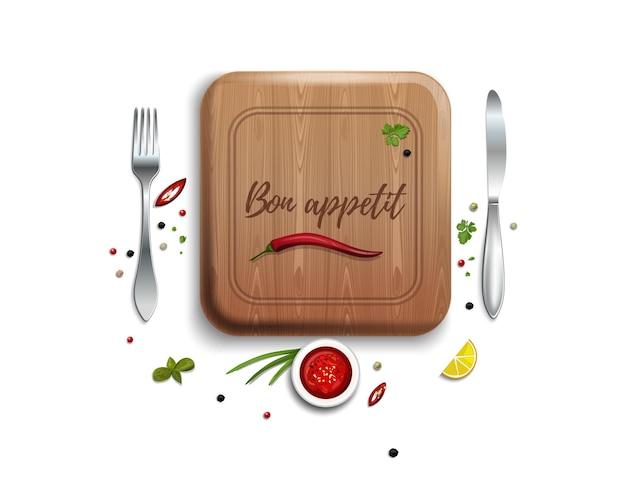 Fourchette, couteau et planche à découper. lettrage - bon appétit.