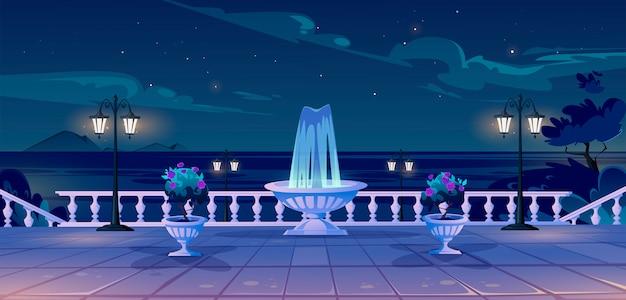 Front de mer d'été au quai de nuit avec vue sur l'océan