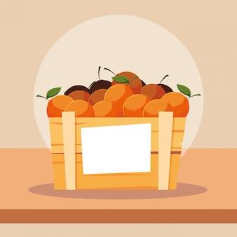 Fruits d'oranges fraîches dans une caisse en bois