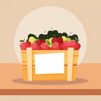 Fruits pommes fraîches dans une caisse en bois