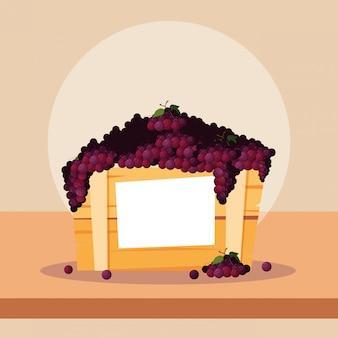 Fruits de raisins frais dans une caisse en bois