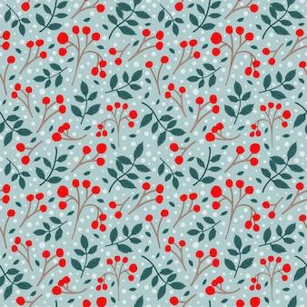 Fruits rouges et petite branche avec un motif de congé sans soudure