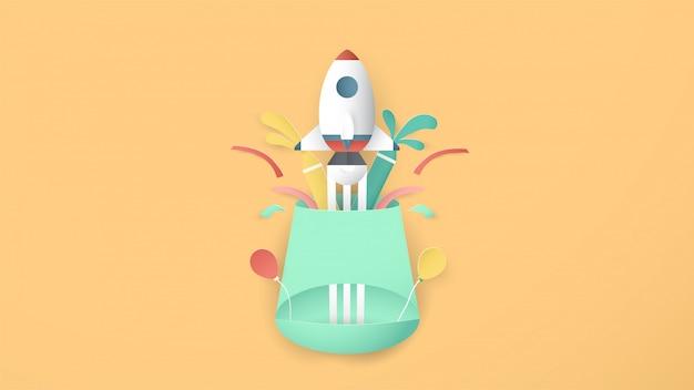La fusée d'art de papier vole. c'est de l'artisanat d'art pour les enfants.