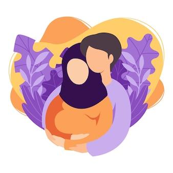 Les futurs parents musulmans homme et femme attendent un bébé. un couple islamique de mari et femme se prépare à devenir parents. homme embrassant une femme enceinte avec le ventre. maternité, paternité. appartement .
