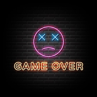 Game over neon signs style texte sur un fond de mur noir