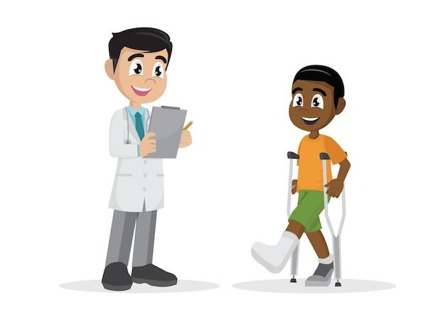 Le garçon africain avec une jambe plâtrée et des béquilles à côté du médecin.