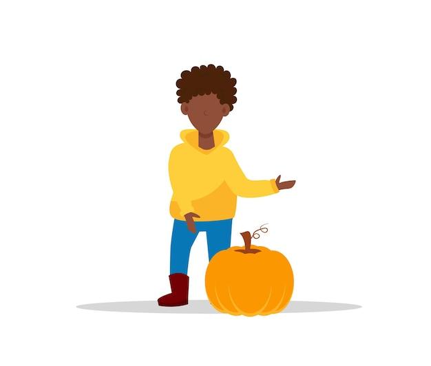 Garçon Afro-américain En Sweat à Capuche Jaune Avec Citrouille. Une Vecteur Premium