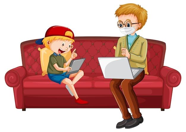 Garçon assis sur un canapé apprenant à partir d'une tablette avec son père