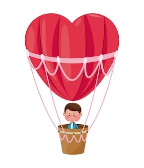 Garçon battant coeur ballon d'air valentine jour