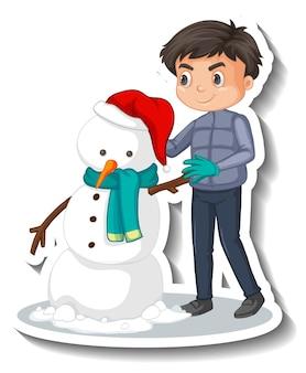 Garçon construisant un autocollant de dessin animé de bonhomme de neige