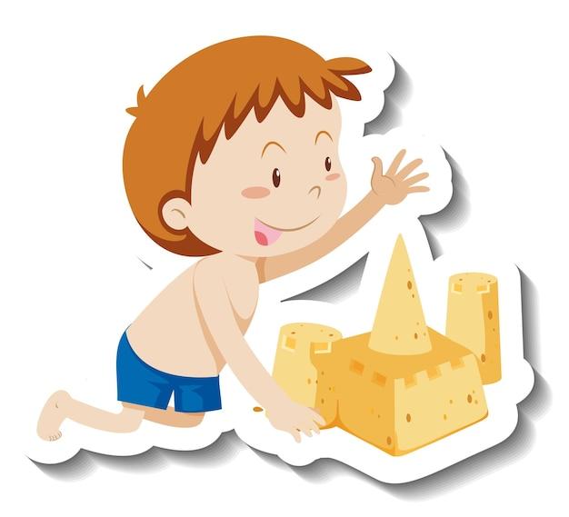 Un garçon construisant un autocollant de personnage de dessin animé de château de sable