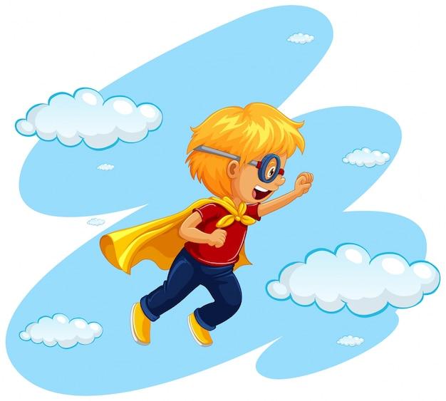 Garçon en costume de héros voler dans le ciel