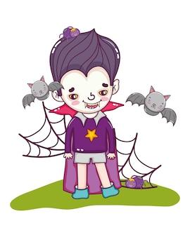 Garçon avec un costume de vampire et des chauves-souris avec des araignées