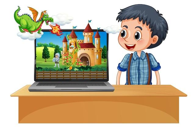 Garçon à côté d'un ordinateur portable avec château sur l'écran du bureau