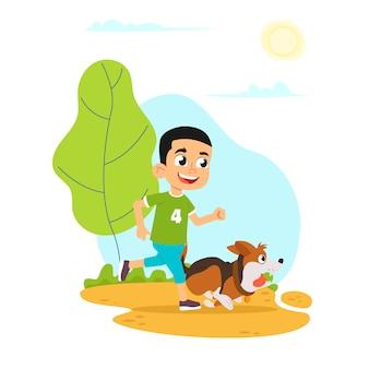 Le garçon court avec un chien.